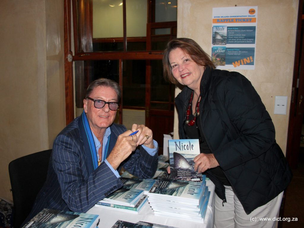 Richard Peirce Signs A Book For Hermanus Resident Catherine Wright